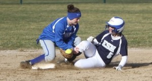 Second baseman Sara Tucci tags the runner for an out. (RiverheadLOCAL photo by Peter Blasl)