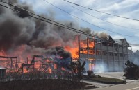 Fire engulfs the Sandpiper co-op apartments on Dune Road in Westhampton Beach Wednesday afternoon. Photo: Ryan Schroeher